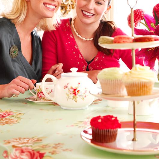 two ladies enjoying high tea